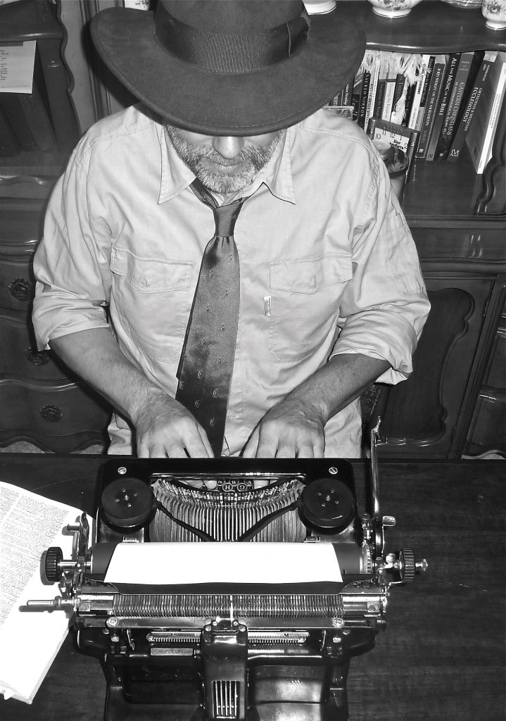 "I liked Julie's answer on Facebook when a friend asked of these photos, ""Does Fred really do that?"" She replied, ""Pose for goofy photos? Check. Use antique typewriters all the time? That, too. Sit around in a fedora and tie? Not so much."""